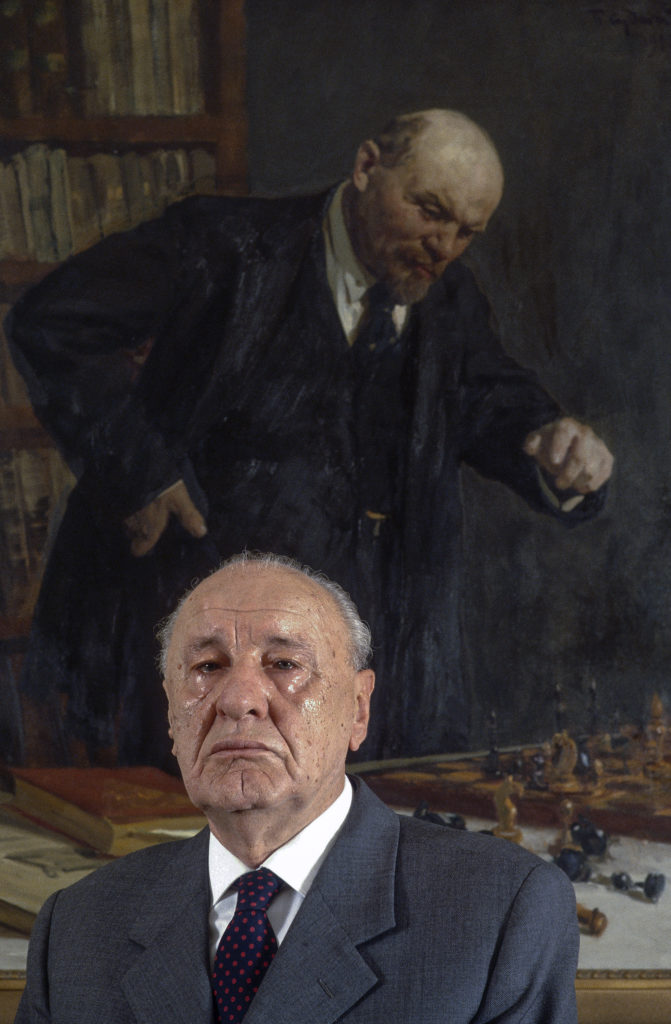 Janos Kadar, General SEcretary of the Hungarian Communist Party, Budapest 1986. With his favourite painting of Lenin playing chess. Photo: Chris Niedenthal